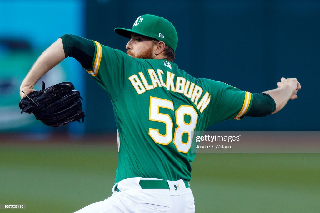 Paul Blackburn #58 of the Oakland Athletics pitches against the Cleveland Indians during the first inning at the Oakland Coliseum on June 29, 2018 in Oakland, California.