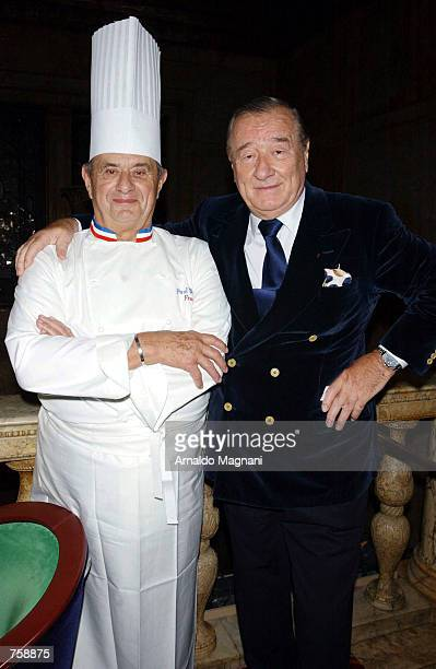 Paul Bocuse a chef from France and Sirio Maccioni of Le Cirque Restaurant pose for a photograph during a cocktail party hosted by Sirio Maccioni of...