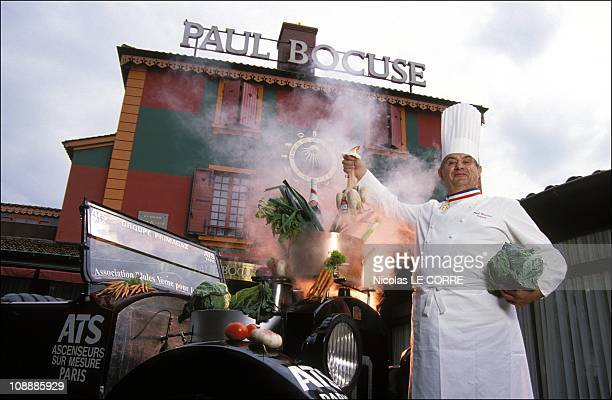 Paul Bocuse christens the '1922 Stanley steam car' before its world tour in 80 days on May 24 1992 in LyonFrance
