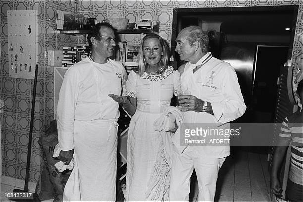 Paul Bocuse Elliet Karajane and Eddie Barclay during the 'Nuit Blanche' event held by Eddie Barclay on July 19 1980 in SaintTropezFrance