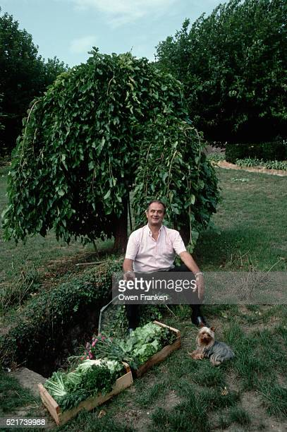 Paul Bocuse Having a Glass of Wine in His Yard
