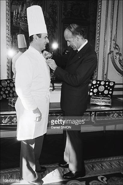 Paul Bocuse is awarded the Legion of Honour by President Valery Giscard d'Estaing at the Elysee Palace on February 25 1975 in ParisFrance
