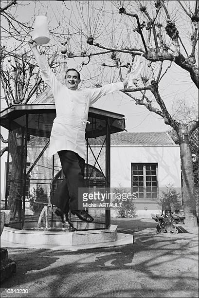 Paul Bocuse is jumping nearby his kitchen during February 1976 in LyonFrance