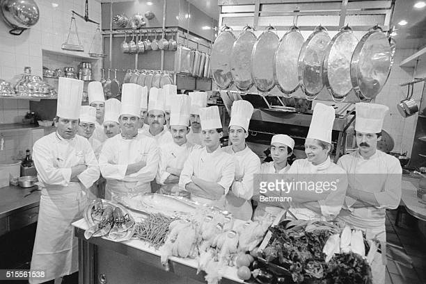 Paul Bocuse the best known chef in France poses with his kitchen crew and a table piled high with chickens and live lobsters Although he no longer...