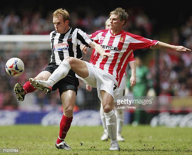 Paul Bolland of Grimsby battles with Brian Wilson of Cheltenham during the League Two Playoff Final match between Cheltenham and Grimsby Town at the...
