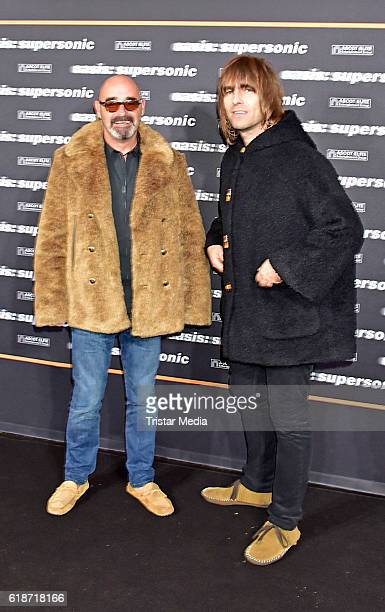 Paul Bonehead Arthurs and Liam Gallagher attend the 'Oasis: Supersonic' German Premiere In Berlin on October 27, 2016 in Berlin, Germany.