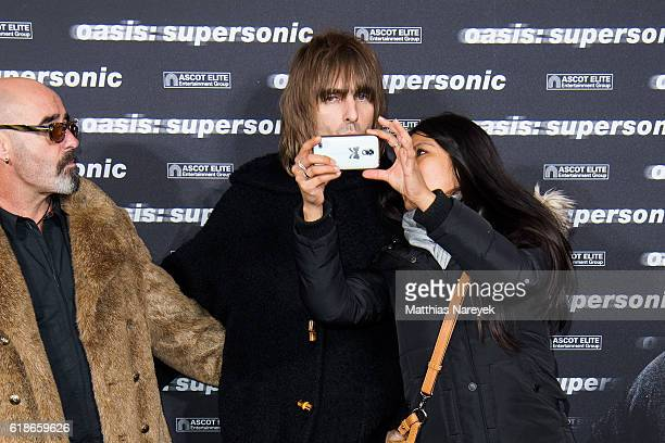 Paul 'Bonehead' Arthurs, Liam Gallagher and a fan during the 'Oasis: Supersonic' German Premiere on October 27, 2016 in Berlin, Germany.