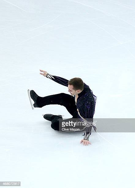 Paul Bonifacio Parkinson of Italy falls while competing in the Men's Figure Skating Men's Free Skate during day two of the Sochi 2014 Winter Olympics...