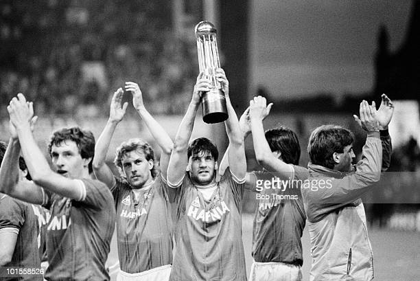 Paul Bracewell of Everton holds aloft the Football League Division 1 Championship trophy following the Everton v West Ham United Division 1 match...