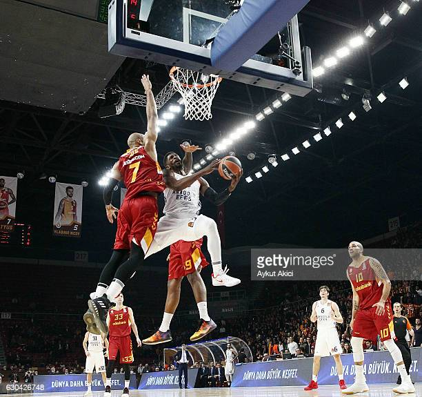 Paul Brandon #33 of Anadolu Efes Istanbul competes with Alex Tyus #7 of Galatasaray Odeabank Istanbul during the 2016/2017 Turkish Airlines...