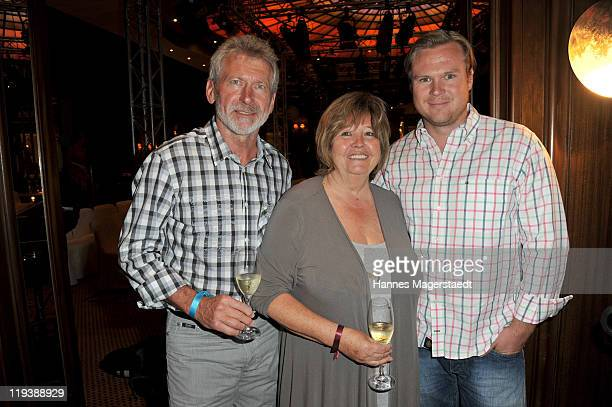 Paul Breitner and his wife Hildegard and son Max Breitner attend the Julia Trentini Fashion Show at Hotel Vier Jahreszeiten on July 19 2011 in Munich...