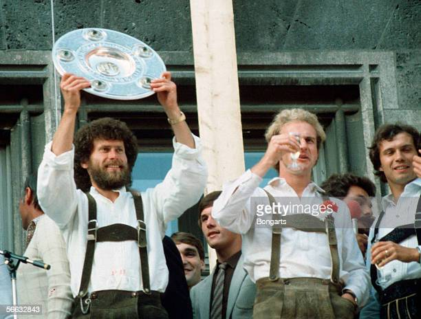 Paul Breitner and KarlHeinz Rummenigge of Bayern Munich celebrates with the trophy after winning the German Championship 1981 at the guildhall on...