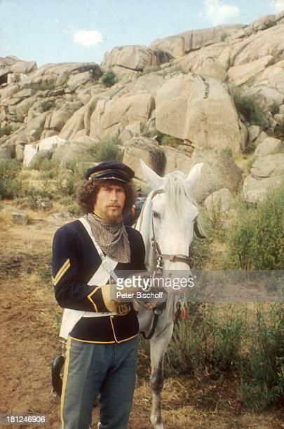 "Paul Breitner , Dreharbeiten zum Kino-Film ""Potato-Fritz"", Madrid/Spanien, , Pferd, Pferde, Felsen, Stein, Cowboy, Hut, Cowboyhut, Kostüm,..."