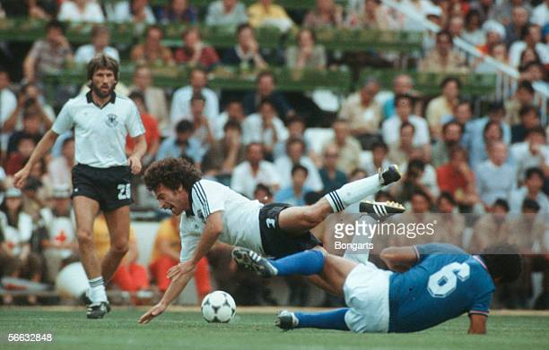 Paul Breitner of Germany and Gaetano Scirea of Italy battle for the ball during the World Cup final match between Germany and Italy at the Santiago...