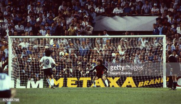 Paul Breitner of Germany score a penalty Jean Luc Ettori of France during of the game Semi Final World Cup match between West Germany and France 8th...