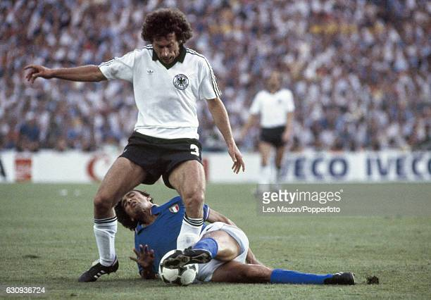Paul Breitner of West Germany is tackled by Alessandro Altobelli of Italy clash during the FIFA World Cup Final between Italy and West Germany at the...