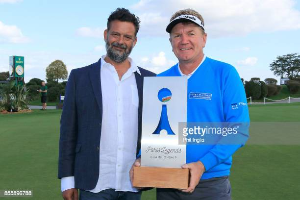 Paul Broadhurst of England and Alexis Sikorsky of Pitch and Play pose with the trophy after the final round of the Paris Legends Championship played...