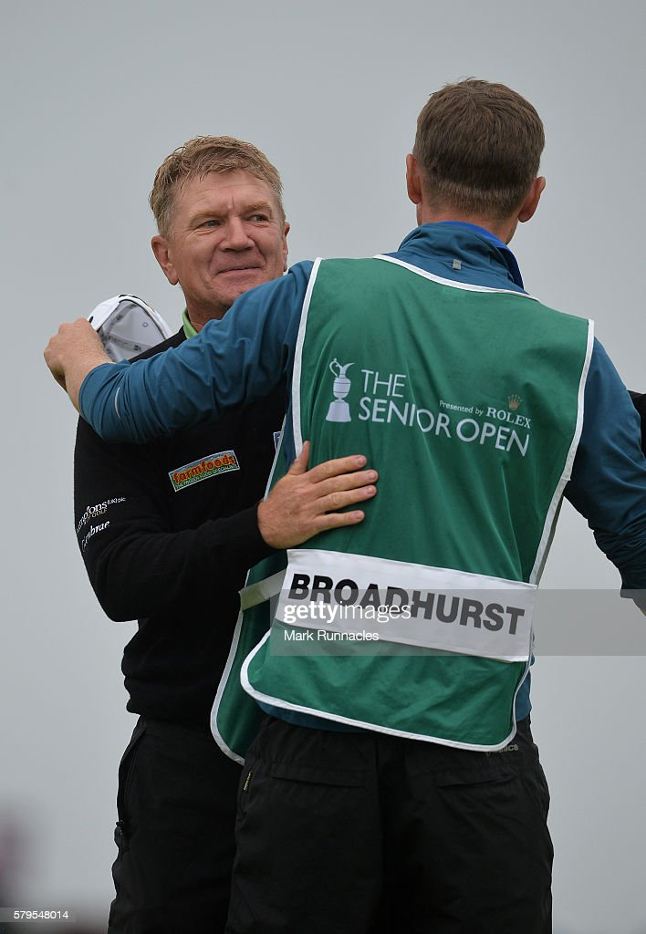 Paul Broadhurst of England celebrates with his son and caddie Sam after holing his final putt on 18 to win The Senior Open Championship at Carnoustie Golf Club on July 24, 2016 in Carnoustie, Scotland.