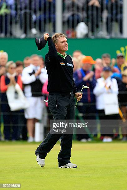 Paul Broadhurst of England holes the winning putt on the 18th green during the final round of the Senior Open Championship played at Carnoustie on...