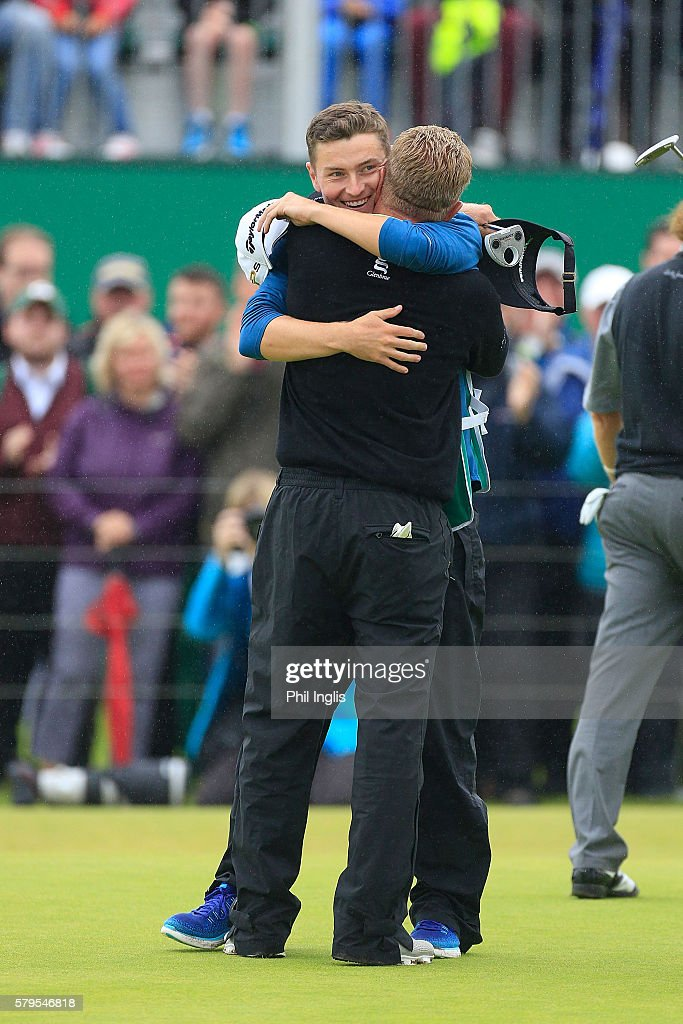 Paul Broadhurst of England hugs his son after the winning putt on the 18th green during the final round of the Senior Open Championship played at Carnoustie on July 24, 2016 in Carnoustie, United Kingdom.