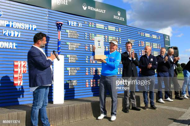 Paul Broadhurst of England lifts the trophy at the prize presentation during the final round of the Paris Legends Championship played at Le Golf...