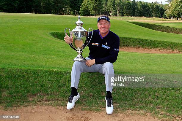 Paul Broadhurst of England poses with the trophy after the final round of the Prostate Cancer UK Scottish Senior Open played at the Fidra Course...