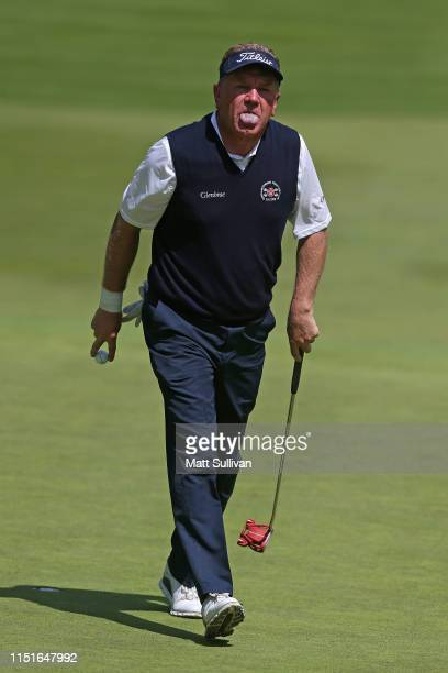 Paul Broadhurst of England reacts to a putt on the 13th hole during the third round of the KitchenAid Senior PGA Championship at Oak Hill Country...