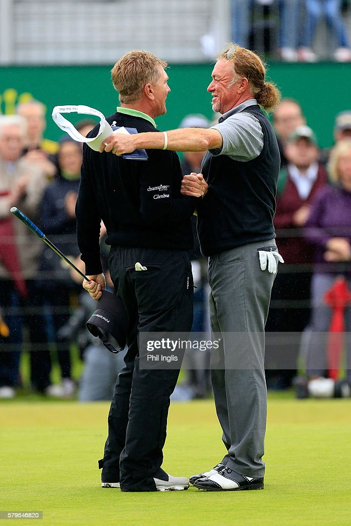 Paul Broadhurst of England shake hands with Miguel Angel Jimenez on the 18th green during the final round of the Senior Open Championship played at Carnoustie on July 24, 2016 in Carnoustie, United Kingdom.