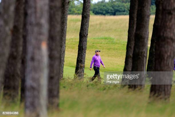 Paul Broadhurst of England walks in the rough on the 3rd hole during the second round of the Scottish Senior Open at The Renaissance Club on August 5...