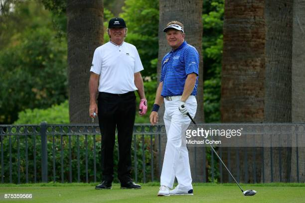 Paul Broadhurst of England watches his drive as Tommy Armour III looks on during the final round of the Charles Schwab Cup Championship held at...