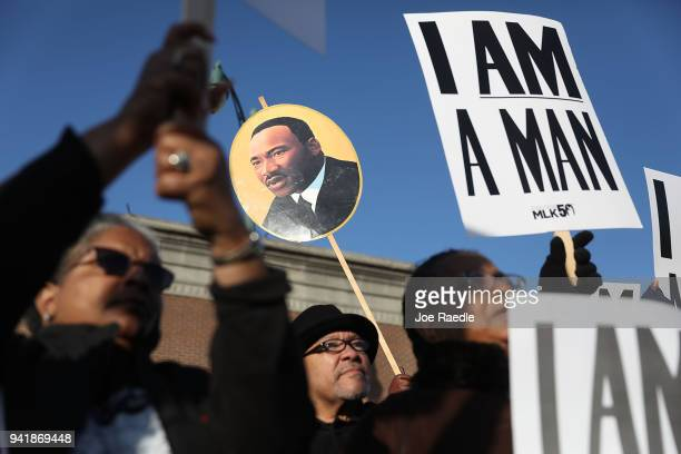 Paul Brooks stands near a picture of Martin Luther King Jr as he participates during an event to mark the 50th anniversary of Dr Martin Luther King...