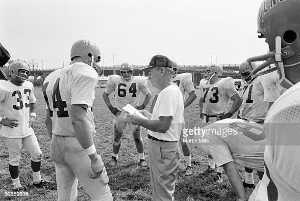 Paul Brown coach and owner of the Cincinnati Bengals with his team during practice circa 1960's