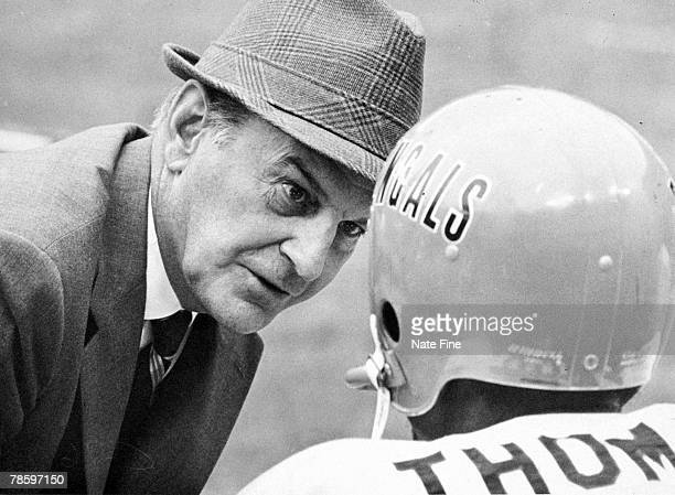 Paul Brown owner and head coach from 1968 to 1975 of the Cincinnati Bengals talks with wide receiver Speedy Thomas on the sideline in a 200 loss to...