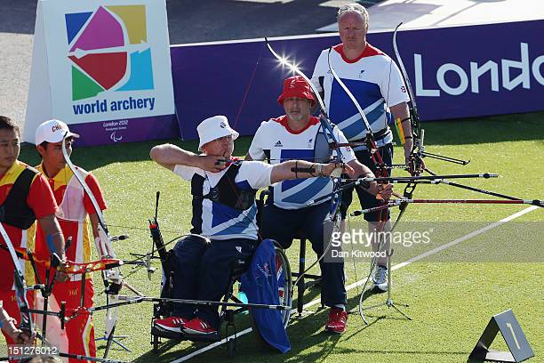Paul Browne Phil Bottomley and Kenny Allen of Great Britain compete in the Men's Team Recurve Open semirfinals againsty China on day 7 of the London...
