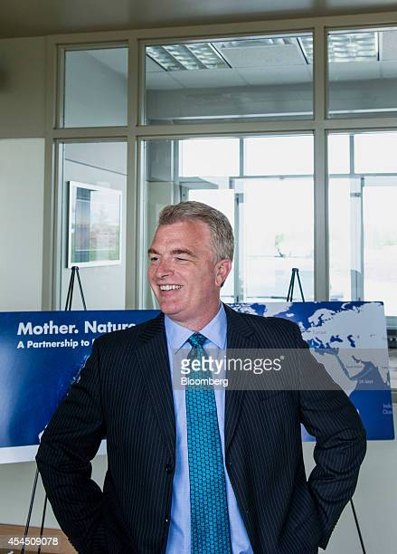 Paul Browning former chief executive officer of Irving Oil Ltd smiles during a tour of the company's refinery in Saint John New Brunswick Canada on...
