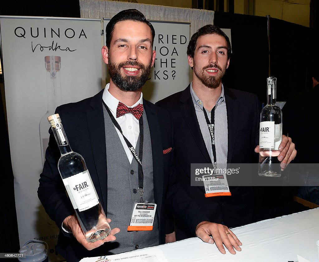 Paul Bungener (L) and Zach Nichols pose at the Fair Spirits booth with their Fair quinoa vodka product at the 29th annual Nightclub & Bar Convention and Trade Show at the Las Vegas Convention Center on March 25, 2014 in Las Vegas, Nevada.