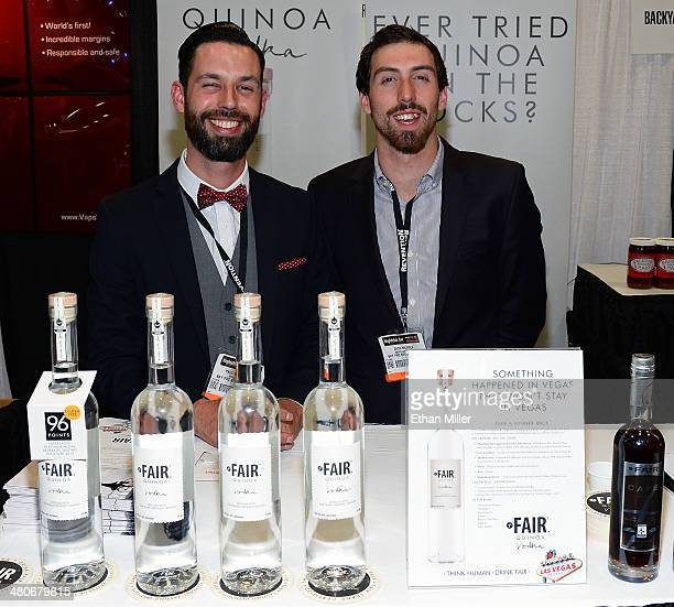 Paul Bungener and Zach Nichols pose at the Fair Spirits booth with their Fair quinoa vodka product at the 29th annual Nightclub Bar Convention and...