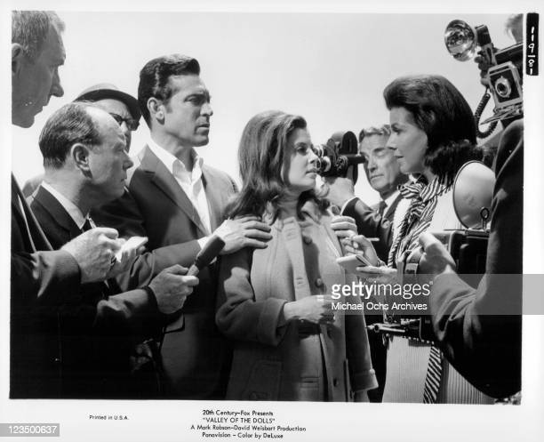 Paul Burke and Barbara Parkins are quizzed by the press in a scene from the film 'Valley Of The Dolls', 1967.