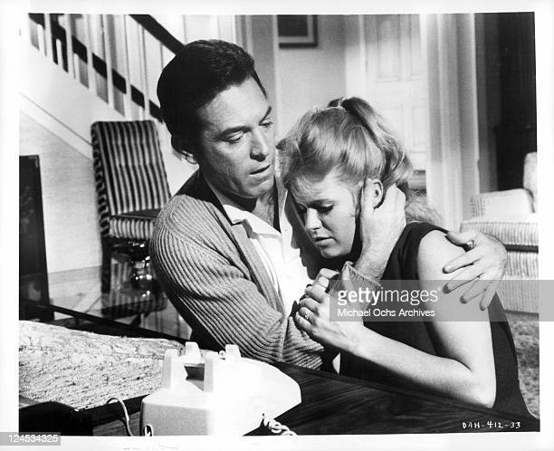 Paul Burke And Carol White embrace in a scene from the film 'Daddy's Gone A Hunting' 1969