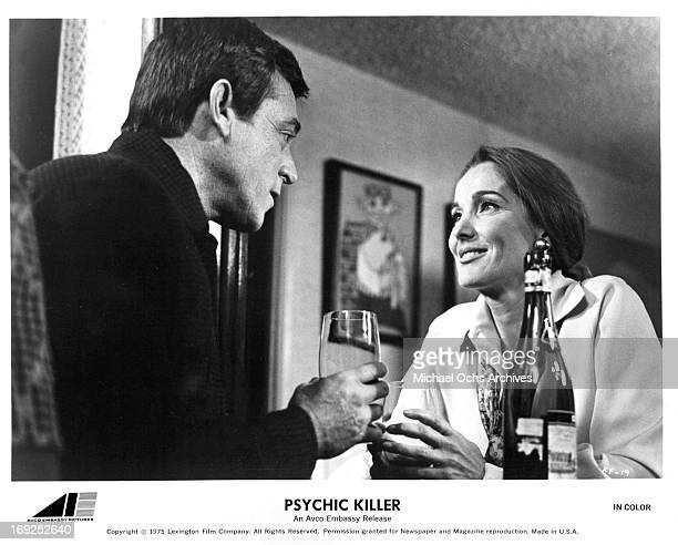 Paul Burke and Julie Adams drink wine in a scene from the film 'Psychic Killer' 1975 Photo by AVCO/Getty Images