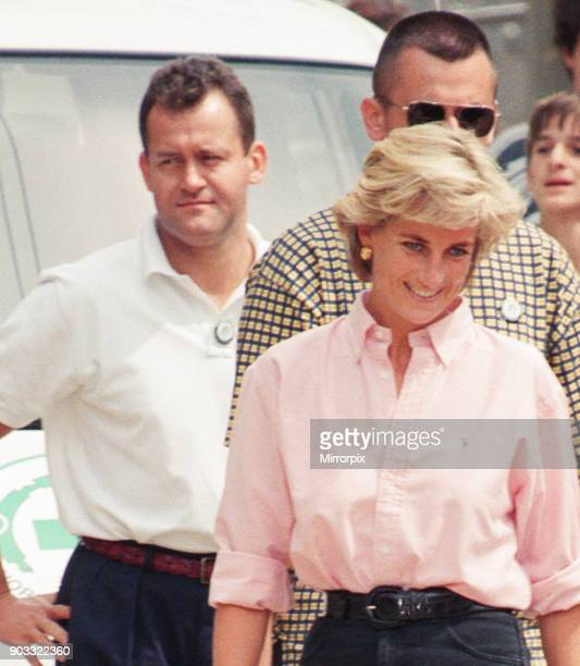 Paul Burrell left in the background in the white shirt and black trousers butler to Diana Princess of Wales as she makes a three day visit to Bosnia...