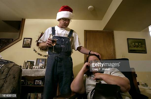 DECEMBER 09 2004 INDIANAPOLIS IN Paul Burton comforts his wife Donna Saine while she talks with her son Sean Lewis on her cell phone Though Burton is...