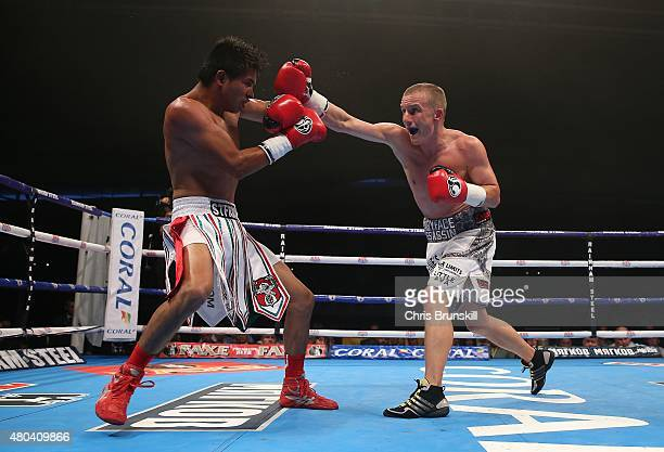 Paul Butler exchanges blows with Gustavo Molina during their superflyweight contest at the Manchester Velodrome on July 11 2015 in Manchester England