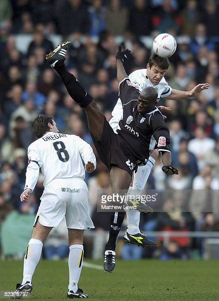 Paul Butler of Leeds wins the header ahead of Mamady Sidibe of Gillingham during the CocaCola Championship match between Leeds United and Gillingham...