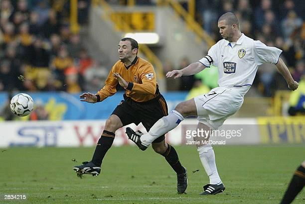 Paul Butler of Wolves is tackled by Domonic Matteo of Leeds during the FA Barclaycard Premiership match between Wolverhampton Wanderers and Leeds...