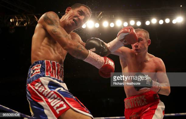 Paul Butler punches Emmanuel Rodriquez during the IBF World Bantamweight Championship title fight between Paul Butler and Emmanuel Rodriguez at The...