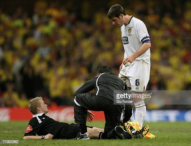 Paul Butler the Leeds Captain gestures for injured Linesman Gavin Ward to leave the pitch and let play continue during the CocaCola Championship...