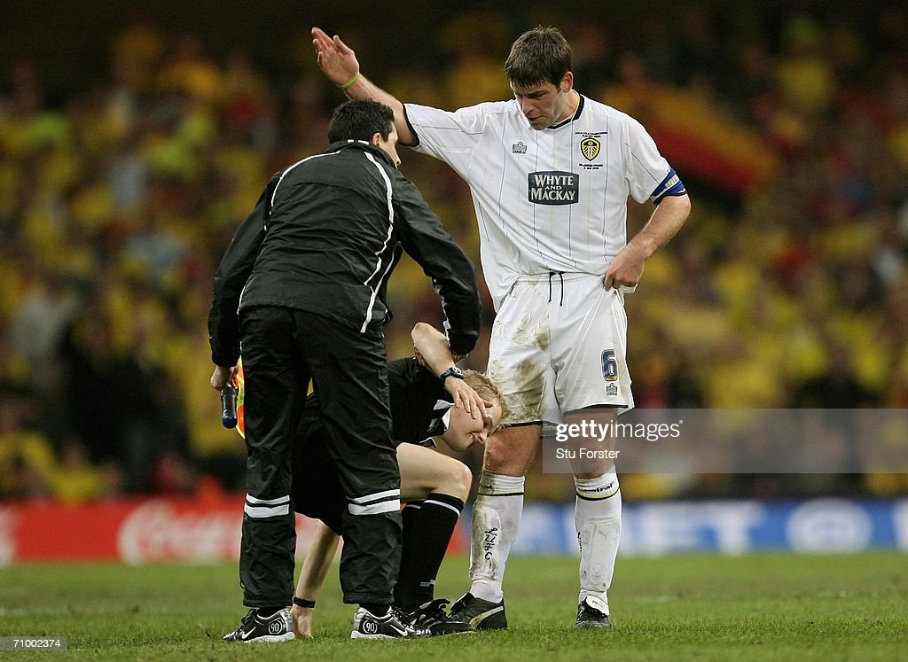 Paul Butler the Leeds Captain gestures for injured Linesman Gavin Ward to leave the pitch and let play continue during the Coca-Cola Championship Playoff Final between Leeds United and Watford at the Millennium Stadium on May 21, 2006 in Cardiff, Wales.