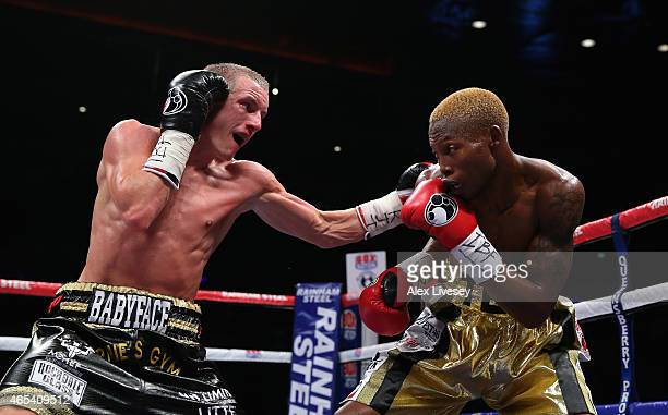Paul Butller lands a left punch on Zolani Tete during the IBF SuperFlyweight Championship of the World fight between Paul Butller and Zolani Tete at...