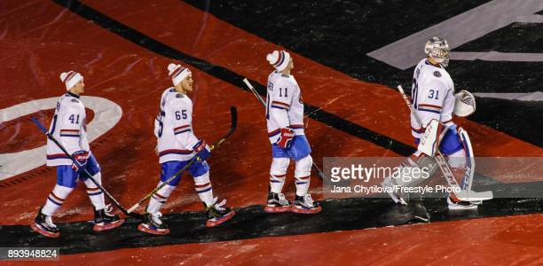 Paul Byron Andrew Shaw Brendan Gallagher and Carey Price of the Montreal Canadiens make their way to the ice surface just prior to the start of their...
